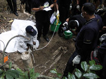 Malajzia, exhumácia, utečenci