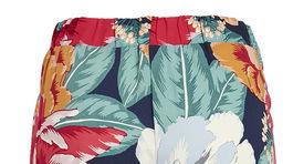 Nohavice s výrazným kvetinovým vzorom Lindex.
