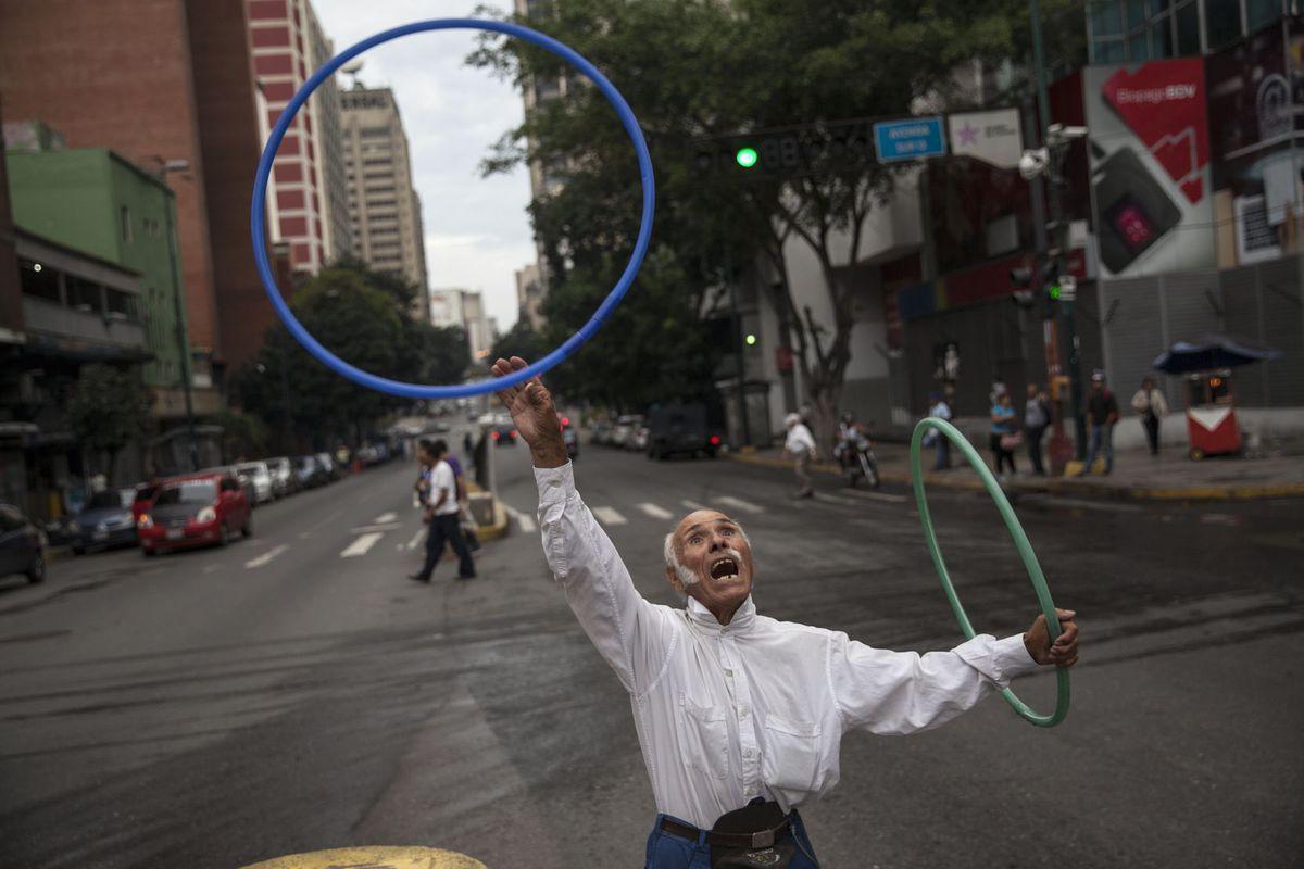 Venezuela, kruhy, akrobat, kaukliar