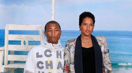 Raper Pharrell Williams a jeho manželka Helen Lasichanh.