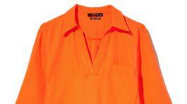 Dámske košeľové šaty vo výraznej oranžovej farbe Reserved, predávajú sa za 29,99 eura.