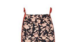 Dámske nohavice z technického materiálu s bočným lampasom. Predáva značka Pinko za 255 eur.