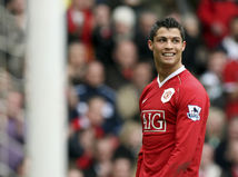 Cristiano Ronaldo smiles during his team's 4-1 win over Bolton Wanderers in their English Premier