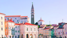 Piran. 09.08.2020. Scenic view of the town of Piran with the main square of Tartini, old colorful buildings with red roofs and the Adriatic Sea with yachts in the coast of Slovenia. Travel concept